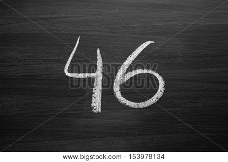number forty six enumeration written with a chalk on the blackboard