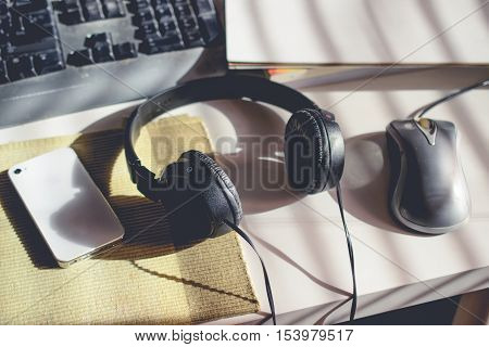 Workplace with Cell Phone Head Phone Keyboard and Blank Book with Beautiful shade