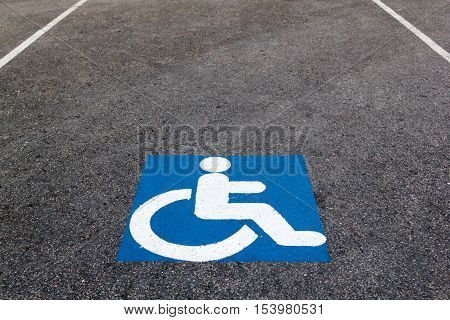 Handicapped Parking Sign Paint Onto Asphalt Parking