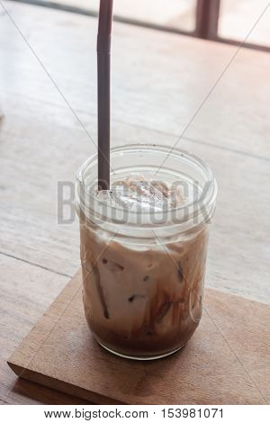 Iced coffee on wooden table, stock photo