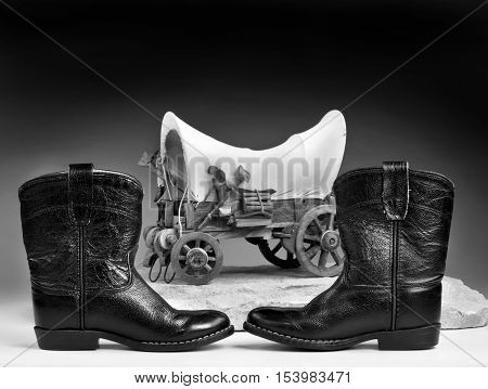 Kids cowboy black boots and chuck wagon with room for your type in black and white.