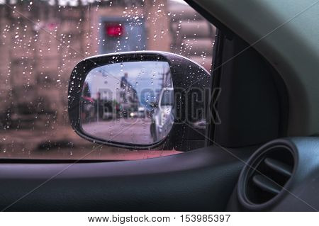 defocused Rain drops on the wing mirror. Abstract background