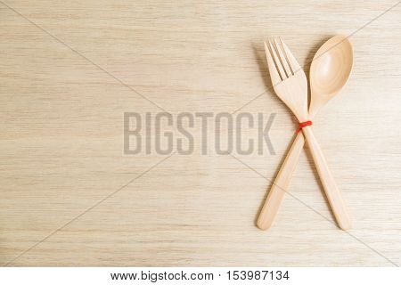 Top view of wooden fork and spoon on wooden table