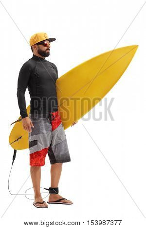 Full length portrait of a male surfer holding a surfboard isolated on white background