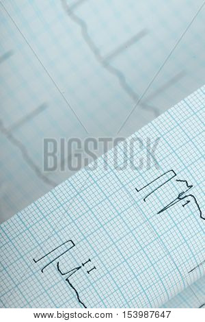 The ECG chart folded paper. Medical background.