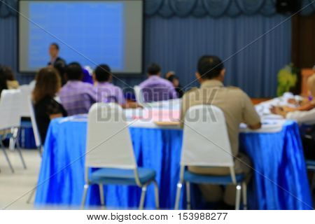 focus blur blurred Business education training conference in room seminar meeting analyze Statistics Financial Concept with projector Movie screen.