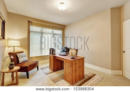 Interior Of Home Office With Beige Walls And Wooden Desk