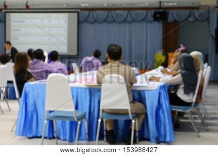 Business blur blurred education training conference in room seminar meeting analyze Statistics Financial Concept with projector Movie screen.