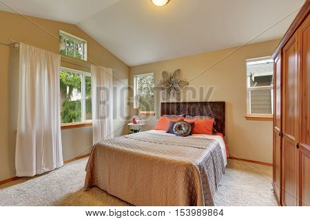 Upstairs Bedroom With Vaulted Ceiling And Beige Walls