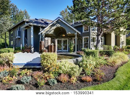 Exterior Of Gray House With Beautiful Landscape Design.