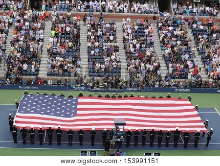 NEW YORK- SEPTEMBER 11, 2016: US Marine Corps unfurling American Flag during the opening ceremony of the US Open 2016 men's final at Billie Jean King National Tennis Center in New York