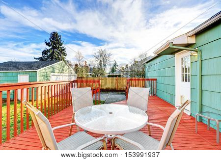 Red Wooden Walkout Deck With Table Set