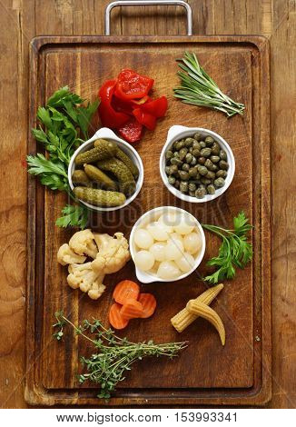 Assorted pickled vegetables (onions, capers, peppers, cucumbers)