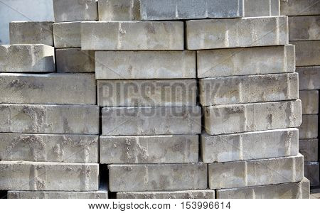 brickwork, construction and building material concept - batch of bricks