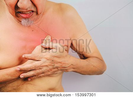 acute pain possible heart attack senior man is clutching he chest