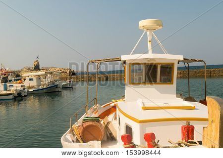 Colorful fish boat against the port of Naoussa at Paros island in Greece.