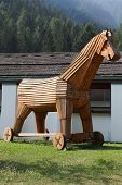 Trojan horse replica in Italy. Wooden military machine. Symbol of treachery and deception. poster