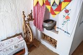 Interior Cossack home. Spinning Wheel oven kettle firewood oven and whitewashed walls poster
