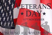 Veterans day background. Text veterans day 11 th november , the USA flag and the shadow of the soldier with the inscription honoring all who served. poster