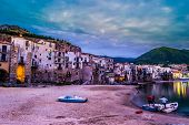 View on habour and old houses in Cefalu at night, Sicily. Beautiful townscape of old italian town. Travel photography. poster