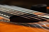 Classical guitar. Issuing a stringed instrument sounds. Fretboard strings and resonation poster