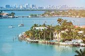 waterfront houses in miami city florida in summer day poster