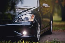 Modern luxury car close - up banner background.
