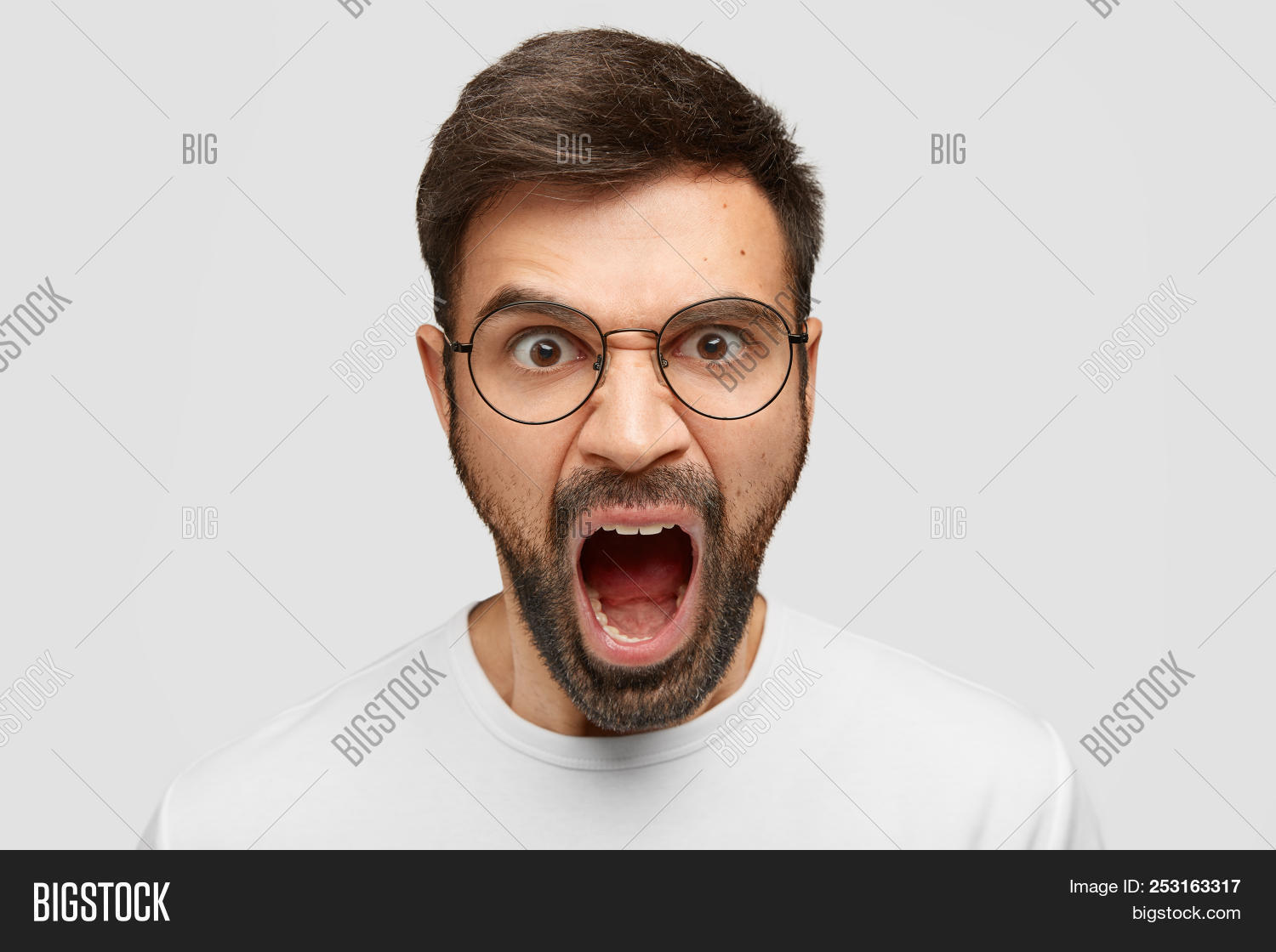 80e56a632a Surprised astonished young man stares with bugged eyes