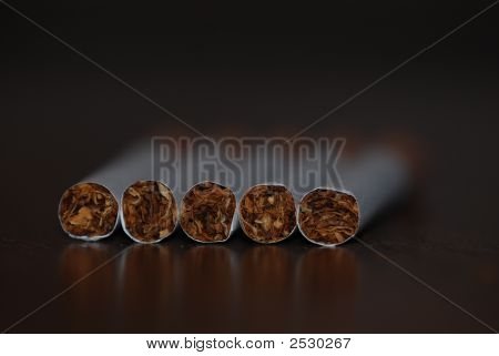 5 Cigarettes With A Shallow Depth Of Field