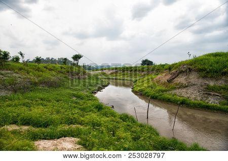 Amazon River In Boca De Valeria, Brazil. Amazon River Flow On Tropical Landscape On Cloudy Sky. Natu