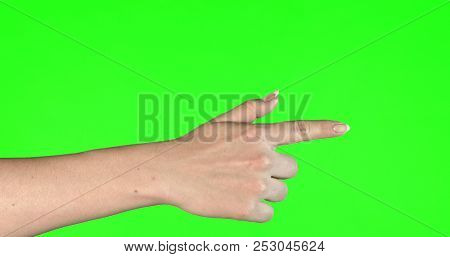 Female hand gestures on green screen: pointing or pressing.