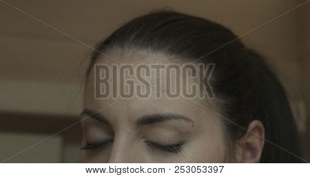 Relaxed woman relaxing in a wooden infrared sauna