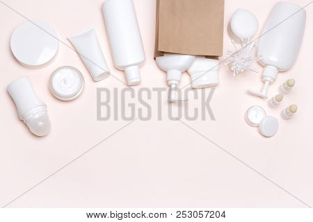 Cosmetic Products With Paper Merchandise Bag. Buying Cosmetics. Beauty Shopping Background. Free Spa