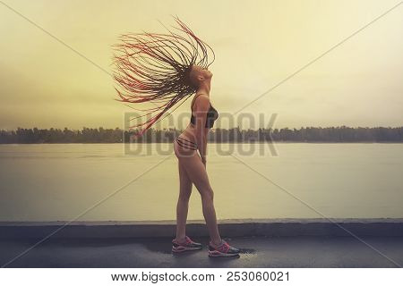 Girl Quickly Raised Her Head Up So That Her Hair Stood Up. Spectacular Movement. Concept Of Freedom.