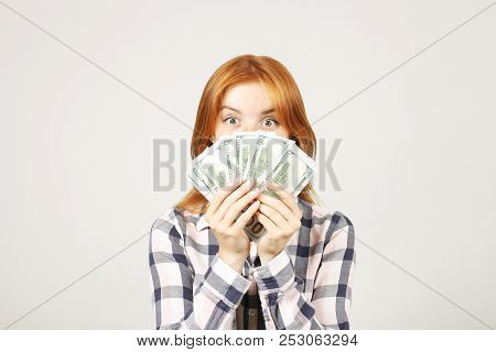 Attractive Young Businesswoman Posing With Bunch Of Usd Cash In Hands Showing Positive Emotions And