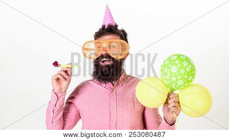 Man With Beard And Mustache On Happy Face Holds Air Balloons, White Background. Party Concept. Hipst