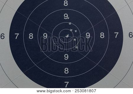 Bullet Holes In The Black Target By A Gun
