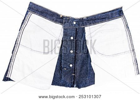 Piece Of Blue Jeans Fabric Isolated On White Background. Rough Uneven Edges. Denim Jeans Torn. Wrong