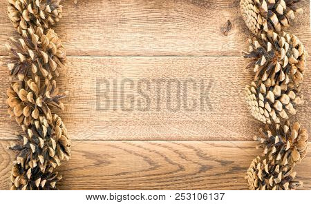 Brown Pinecones On Old Wood Background Top View