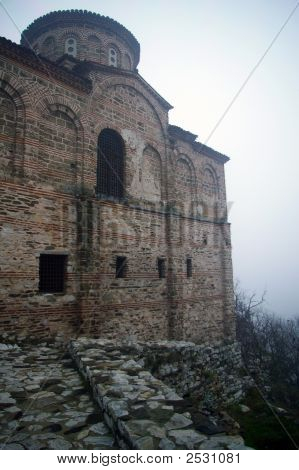 Old Bulgarian Monastery On Top Of Steep Cliff