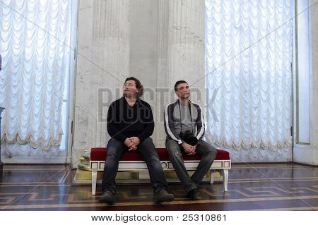 Tourists Resting In The St George Hall