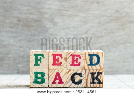 Letter Block In Word Feedback On Wood Background