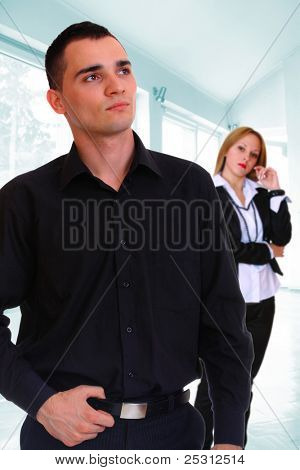 Young business couple in the office