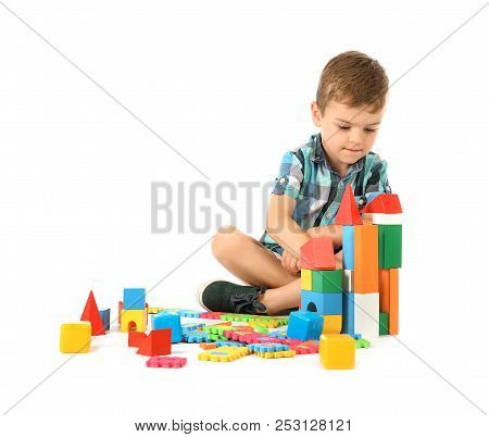 Little Child Playing With Blocks On White Background. Indoor Recreation