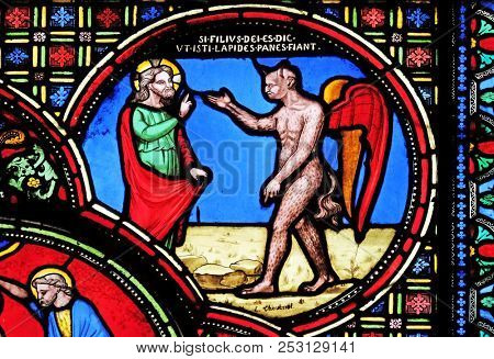 PARIS, FRANCE - JANUARY 09: Jesus tempted by the devil, stained glass window from Saint Germain-l'Auxerrois church in Paris, France on January 09, 2018.