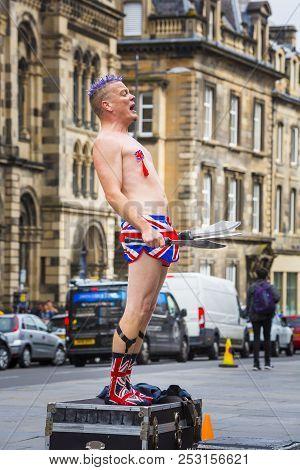 Edinburgh, Scotland  - August 7: Street Performer Spikey Will Standing On A Case At The Edinburgh Fr