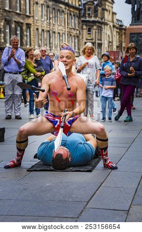 Edinburgh, Scotland  - August 7: Street Performer Spikey Will Juggling At The Edinburgh Fringe Festi
