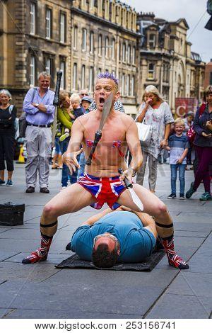 Edinburgh, Scotland  - August 7: Street Performer Spikey Will At The Edinburgh Fringe Festival. Augu