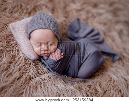 Cute sleeping newborn baby boy