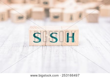 The Word Ssh Formed By Wooden Blocks On A White Table